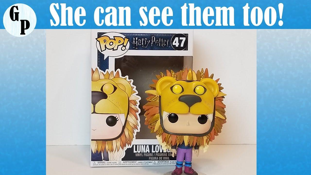 Luna Lovegood wearing Lion Head Harry Potter Funko Pop ...