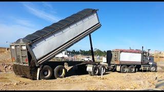 MACK SUPERLINER unloading gravel.