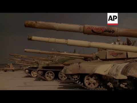 Syrian govt forces show weapons they say rebels handed over