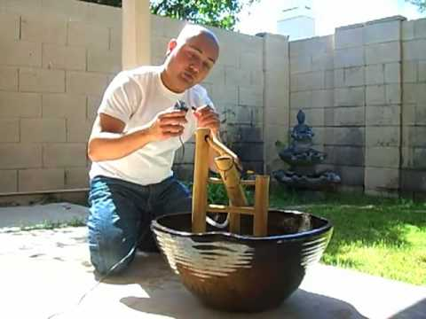 Shishi odoshi deer chaser fountain setup youtube for Japanese bamboo water feature