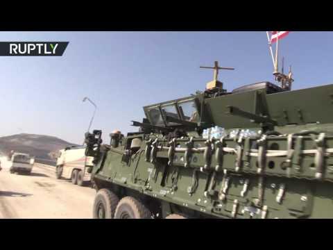 US armoured convoy enter Manbij, Syria