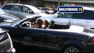 miley cyrus driving audi and gets a tan