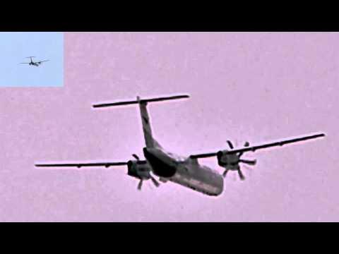 a propeller aircraft on final approach