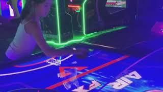 Ella Playing Air Hockey with Roman