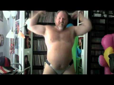 Big Bear In A Silver Speedo Does  A Happy Dance