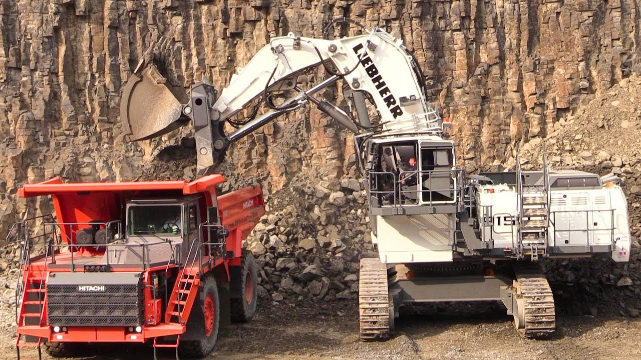 Liebherr R9150 Mining Excavator Loading Hitachi EH1100-5 Mining Truck @ Steinexpo 2014 - YouTube