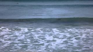Camera recording surfing on sand dune