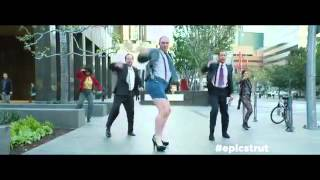 "Bald guy walking in heels to ""Don"