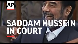 Saddam Hussein in court, says on hunger strike, turbulent scenes