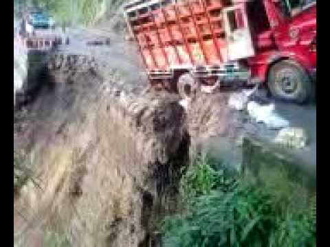 Northern India landslide takes down road and truck