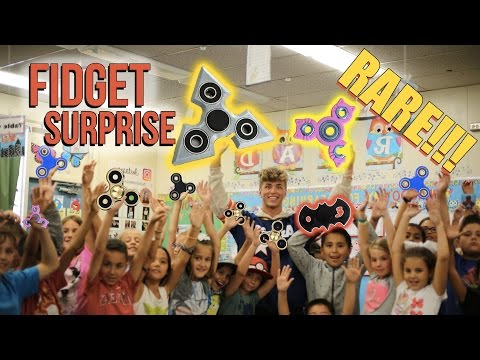 SURPRISE MY WHOLE ELEMENTARY SCHOOL WITH FIDGET SPINNERS! (Hilarious reaction)