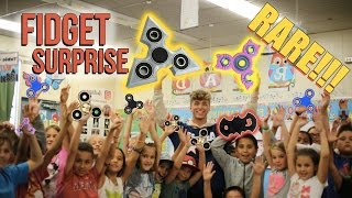 surprise my whole elementary school with fidget spinners hilarious reaction