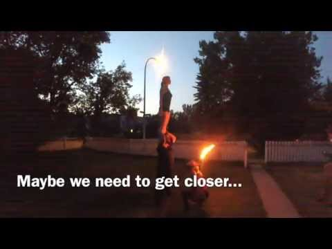 Two girls and one guy fire breathing together.