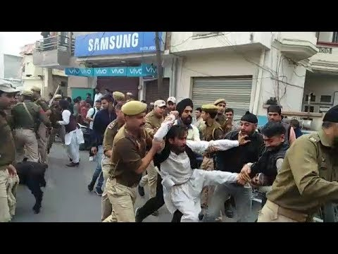 Protesting against eviction Gujjars block Lal Singh's  residence with livestock