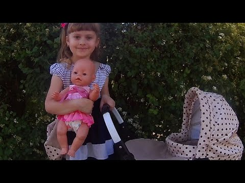 Alina like mom plays with a doll on the playground LINKA ALINKA