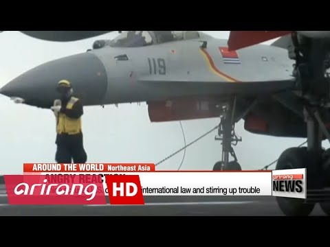 U.S. destroyer sails near disputed island in South China Sea