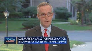 Warren calls for investigation into investor access to Trump briefings
