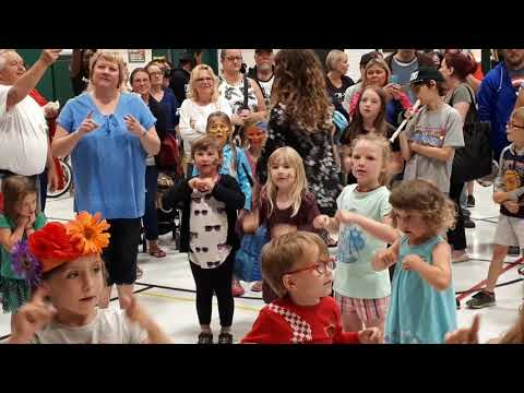Garden party at Forest Park school.  Kindergarten  students sing and dance