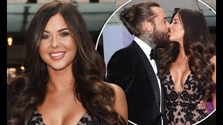 Shelby Tribble dazzles in a plunging gown as she smooches Pete Wicks
