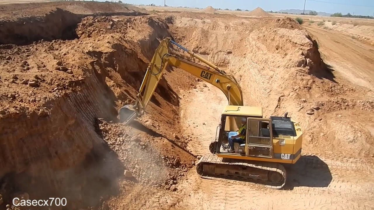 how to build a rock wall with an excavator