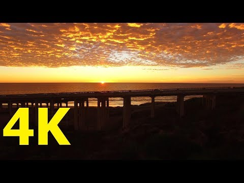 Cinematic Beautiful sunset at bridge in San Diego beach Ocean California by DJI Phantom Professional