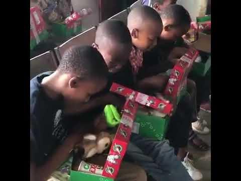 Shoebox joy as boys explore gifts in Tanzania