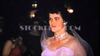 1965: Wedding bride in pink dress solemnly walks down aisle. DAYTON, OHIO