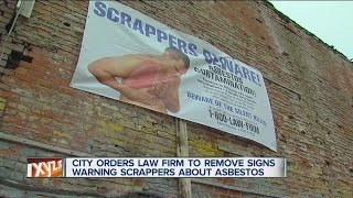 City orders law firm to remove signs warning scrappers about asbestos