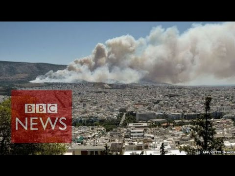 Greece fires: Forest fire rages in Athens suburb