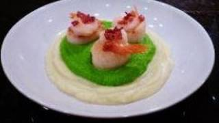 Scallops On A Bed Of Cauliflower And Pea Purée With Bacon Crumble