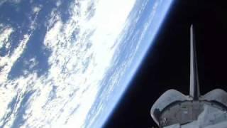 Space Shuttle Orbits Earth
