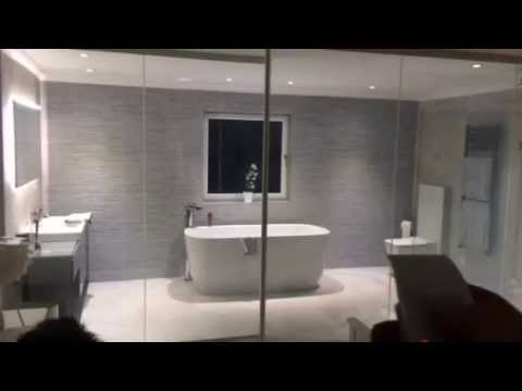 Smart glass laminated bathroom partition from Intelligent Glass
