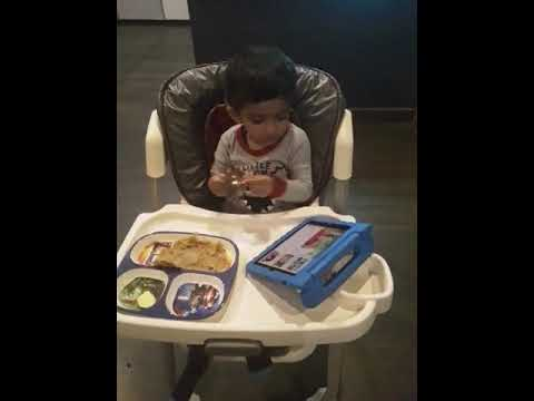 2.5 year old kid playing Manjira— Indian musical instrument