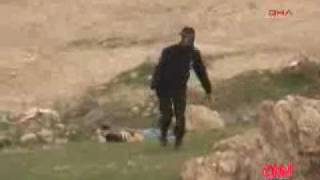 Turkish soldier beats a Kurdish child unconscious