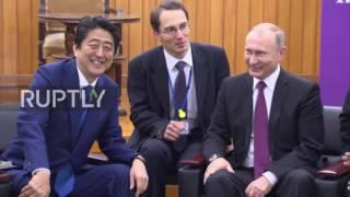 Japan: Abe and Putin share a joke after Kodokan Judo Institute visit