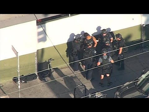 Gunman arrested after Los Angeles store hostage standoff