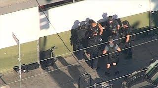 Gunman arrested after Los Angeles store hostage standoff