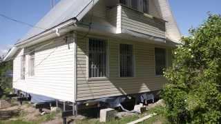 видео как поднять щитовой дом домкратом цена
