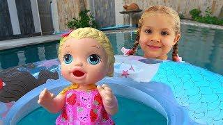 Diana y su día super divertido con la Muñeca Bebe