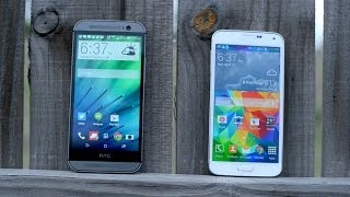 HTC One M8 vs Samsung Galaxy S5! (Review)