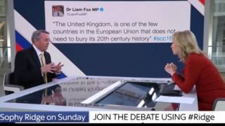 The disgraced Liam Fox denies sending Tweet while sitting in front of a giant picture of it