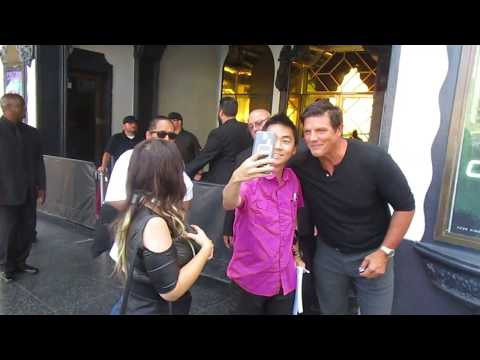 Paul Johansson greets  outside of Avalon Hollywood for LAPD Celebrity Poker Night