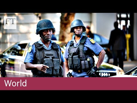 South African police raid Gupta home