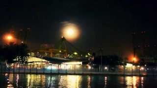 Full Moon above Ship Port of Singapore in Asia