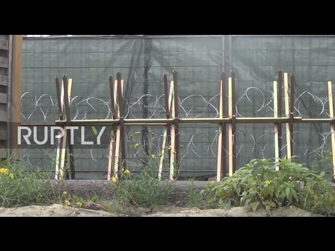 Germany: Company erects barbed razor-wire fence to keep out refugee ...