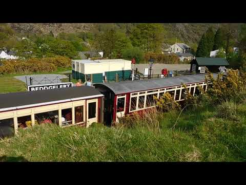 Beddegelert station and Porthmadog bound train from mound behind station