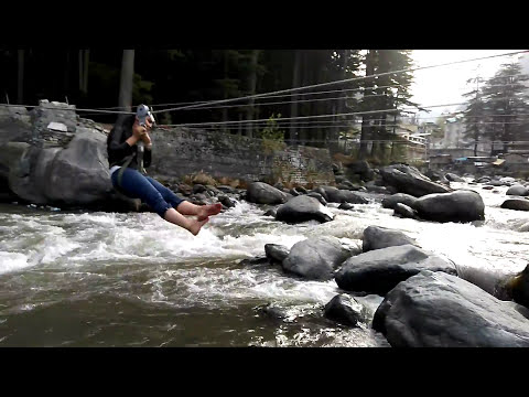 Tourists enjoying  at the bank of river Beas , Manali