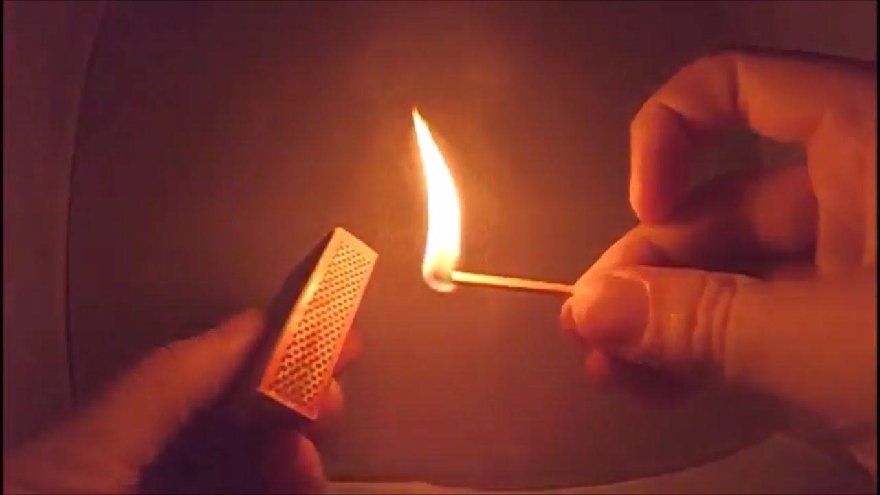 Lighting a match in