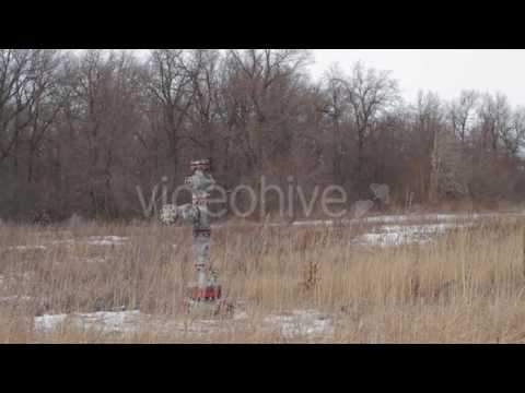 Well Pad With Oil Well Christmas Tree Equipment - Stock Footage | VideoHive 14840703