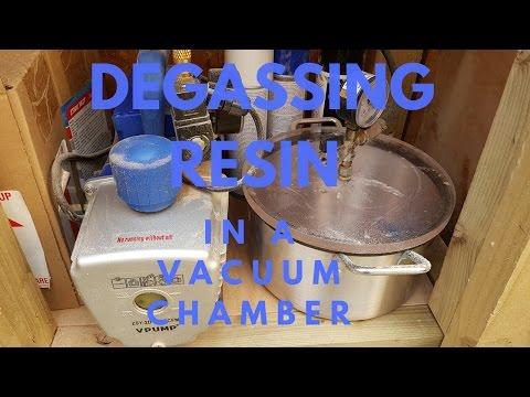 Degassing resin in vacuum chamber.